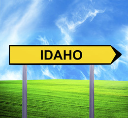 Conceptual arrow sign against beautiful landscape with text - ID
