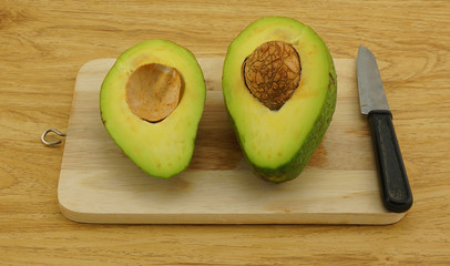 Fresh avocado on cutting board