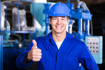 factory worker giving thumb up