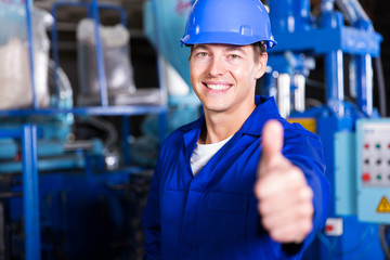 worker thumb up in factory