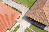Old and news roof with colorful ceramic tiles - 71239406