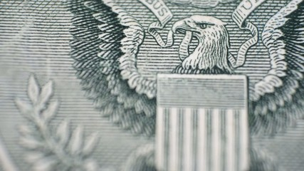 Extreme close up view of dollar bill changed