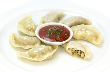 Nepalese food momo on a white background in the restaurant