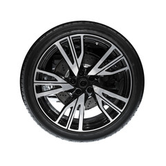 Photo of new automotive wheel on black disc isolated on white ba