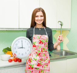 housewife with a clock and a ladle in her hands