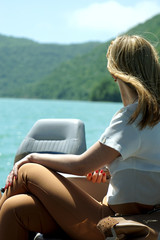 the girl on the boat admires a landscape