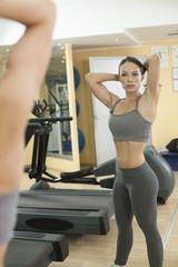 Beautiful Fit Women exercise in the gym.