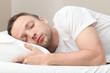 Leinwandbild Motiv Portrait of sleeping Young Caucasian man in white
