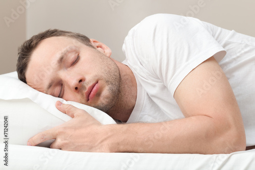Portrait of sleeping Young Caucasian man in white - 71242041