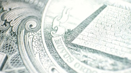 close up view of  dollar currency - eagle to pyramid pan