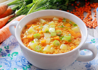 Vegetable soup with carrots, leek and lentils