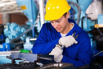 repairman using spanner