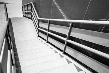 Industrial metal staircase perspective. Black and white photo