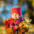 canvas print picture - Little girl playing with autumn leaves