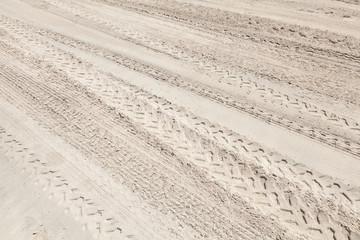 A lot of ATV tracks on the white sand beach