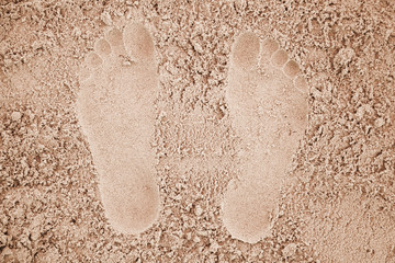Man footprints in yellow sand on the beach
