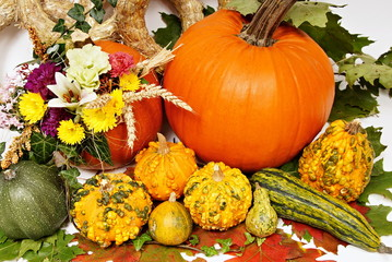 Autumn decoration with pumpkin, flowers and leafs