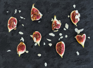 Fresh cutted figs with almond petals