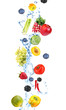 Fresh fruit, berries and vegetables with water splash, isolated