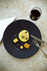 Egg, corn, polenta and black olive