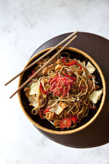 Asian noodles with tofu, shrimp, peppers and sauce