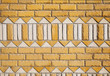 Yellow brick wall texture with white ornament pattern