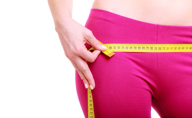 Fitness woman fit girl with measure tape measuring her loins