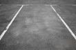 canvas print picture - Empty parking place with white marking lines on asphalt