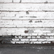 Urban background interior with old white brick wall and asphalt