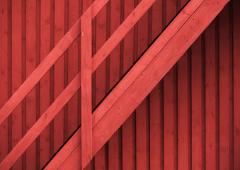 Scandinavian red rural wall and staircase with railing