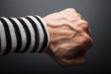 Close up photo of sailor fist  on a dark background