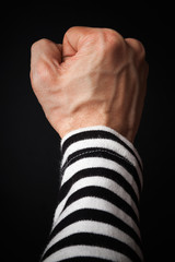 Closeup photo of sailor fist  on a dark background