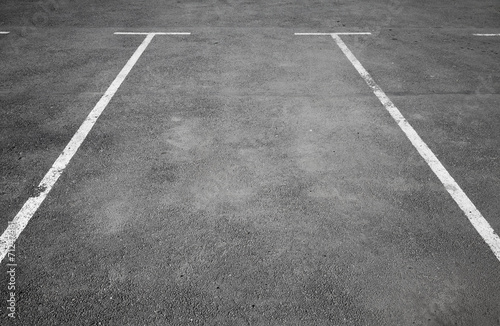 canvas print picture Empty parking place with white marking lines on asphalt