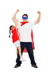 asian little girl hanging his father arm with superhero suit.
