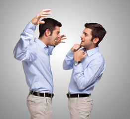 Man attacking a frightened clone of himself