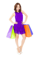 pretty young woman walking and holding shopping bags