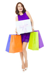 happy young woman holding shopping bag and a gift boxes
