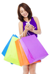 young pretty woman holding a cell phone to shop online