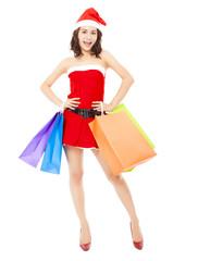 Christmas santa woman holding some gift bags