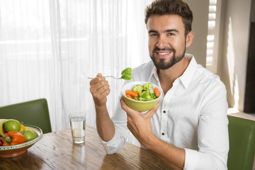 Man showing his healthy meal and smiling