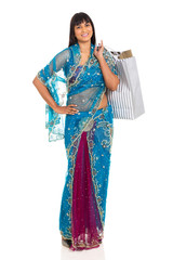 indian woman in saree carrying shopping bags
