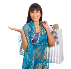 indian woman in traditional clothes carrying shopping bags