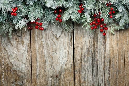 Christmas fir tree on wooden background - 71248012
