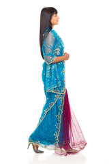 side view of indian woman in saree walking