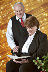Mature Couple Reading Scripture at Christmastime