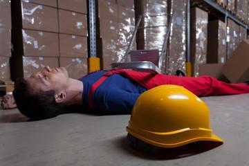 Man on the floor in factory