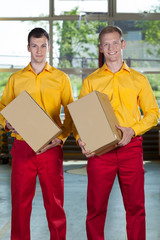 Factory workers with boxes