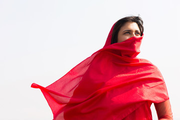 indian woman in sari covering her face
