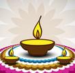 Rangoli and a decorated illuminated diwali diya card background