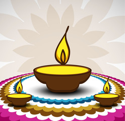 Rangoli and a decorated illuminated diwali diya card background